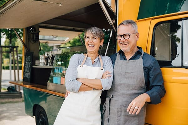Older couple opening a food truck